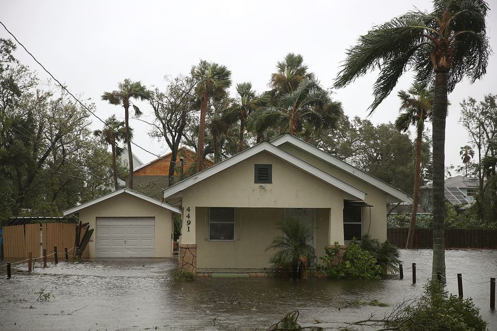 A home is surrounded in by flood waters on in Port Orange, Florida.
