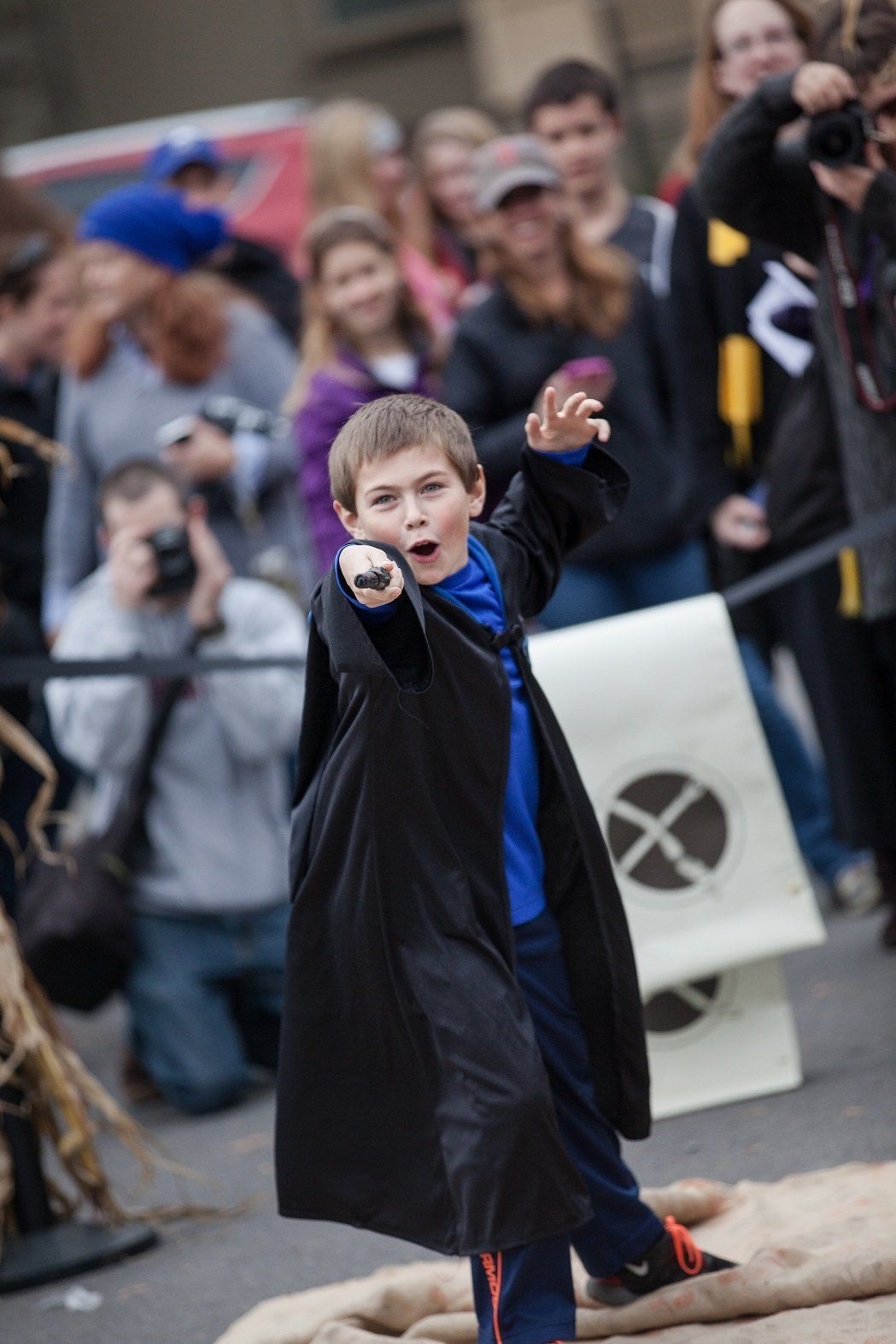 A young wizard displays his wand during last year's Wizarding Weekend in Ithaca, New York.