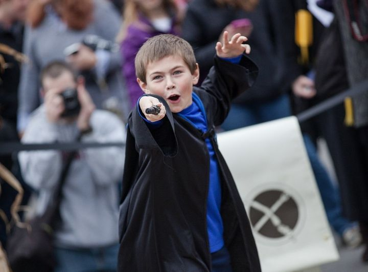 A young wizard displayshis wand during last year's Wizarding Weekend in Ithaca, New York.