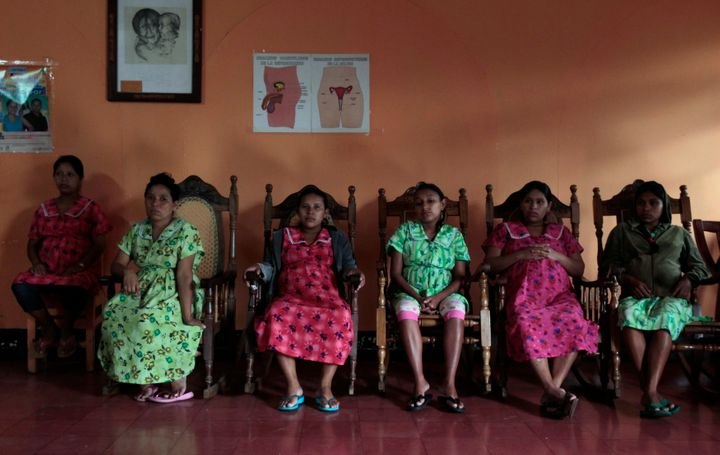 Pregnant teenagers sit inside a maternity home in Jinotega city, some 160 km (99 miles) north of Managua October 24, 2013. Ac