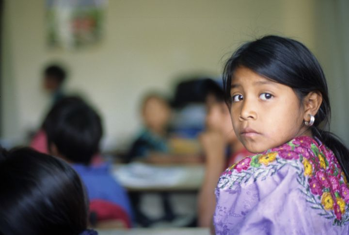 Portrait of a young Mayan student in her classroom in Guatemala.