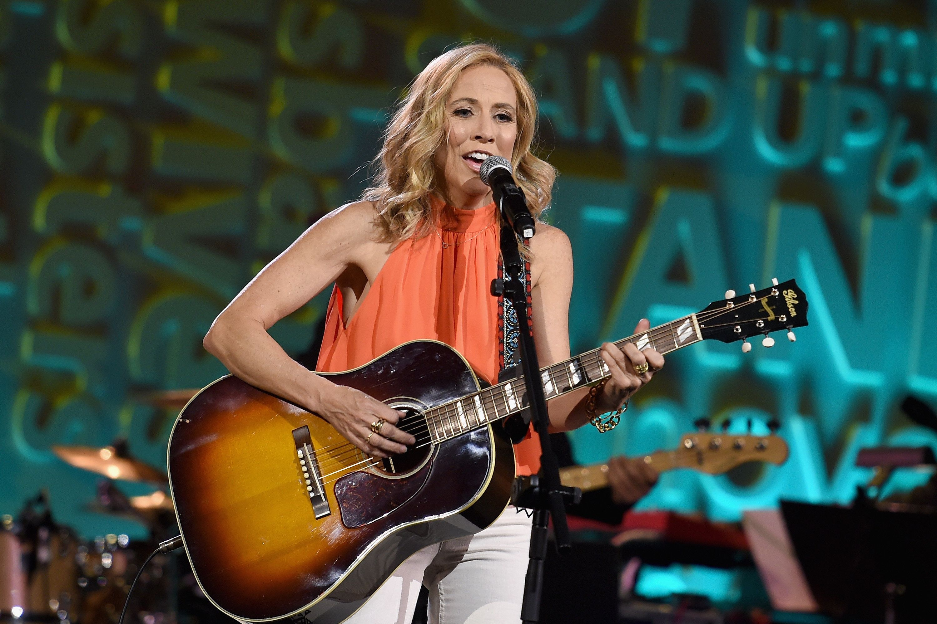 NEW YORK - APRIL 09:  (EXCLUSIVE COVERAGE)   Recording artist Sheryl Crow performs onstage during Stand Up To Cancer's New York Standing Room Only, presented by Entertainment Industry Foundation, with donors American Airlines and Merck, chaired by Jim Toth, Reese Witherspoon & MasterCard President/CEO Ajay Banga and his wife Ritu, honoring Katie Couric at Cipriani Wall Street on April 9, 2016 in New York City.  (Photo by Jamie McCarthy/Getty Images for EIF)
