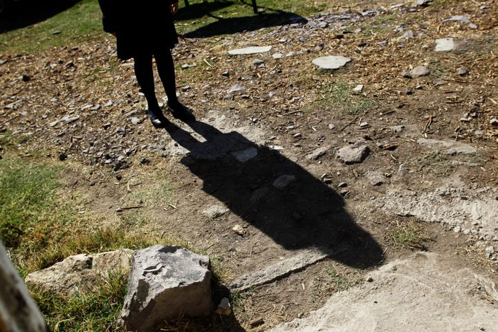 A schoolgirl casts her shadow on a dirt floor while talking to Reuters about having been sexually abused in Ecatepec, Mexico.