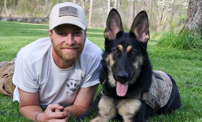Christopher Baity a veteran Marine Corps Dog Trainer and founder of Semper K9 Assistance Dogs is the 2016 recipient of the Red Bandanna Hero Award