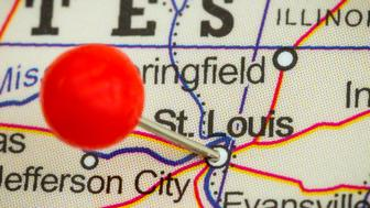 Close-up of a red pushpin on a map of St. Louis, USA.