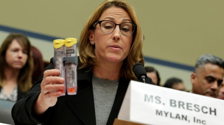 Mylan NL CEO Heather Bresch holds EpiPens during a House Oversight and Government Reform Committee hearing on the rising pric