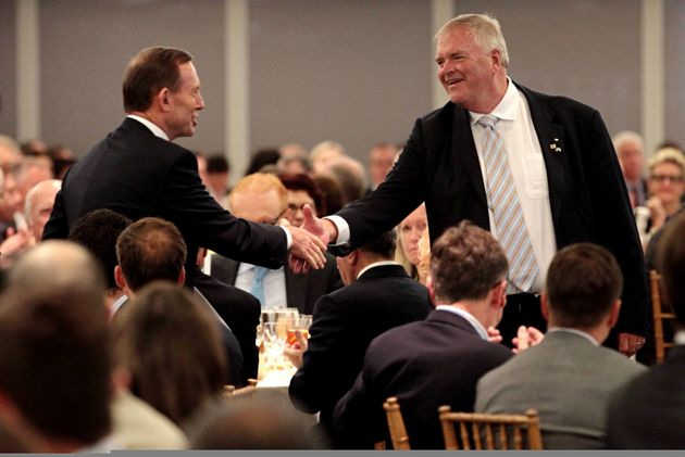 Australian Prime Minister Tony Abbott greets Australian Ambassador to the U.S. Kim Beazley