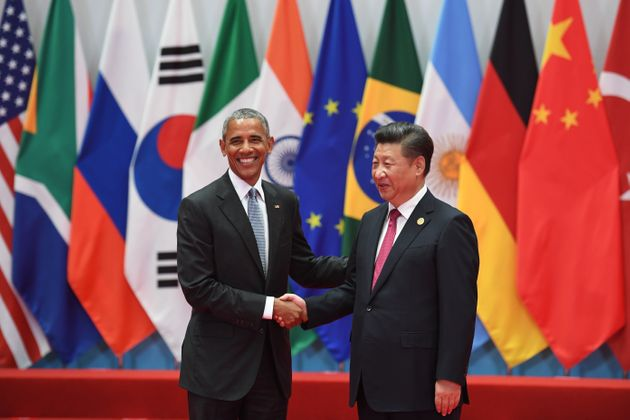 China's President Xi Jinping shakes hands with U.S. President Barack Obama before the G20 leaders' family...