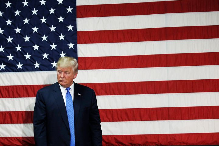 Republican presidential nominee Donald Trump pauses as he speaks at a campaign town hall event in Sandown, New Hampshire,&nbs