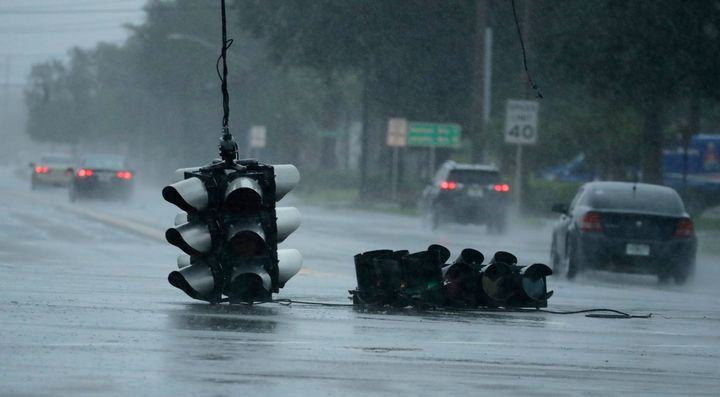 A traffic light hangs in an intersection as Hurricane Matthew moves through Jacksonville, Fla.