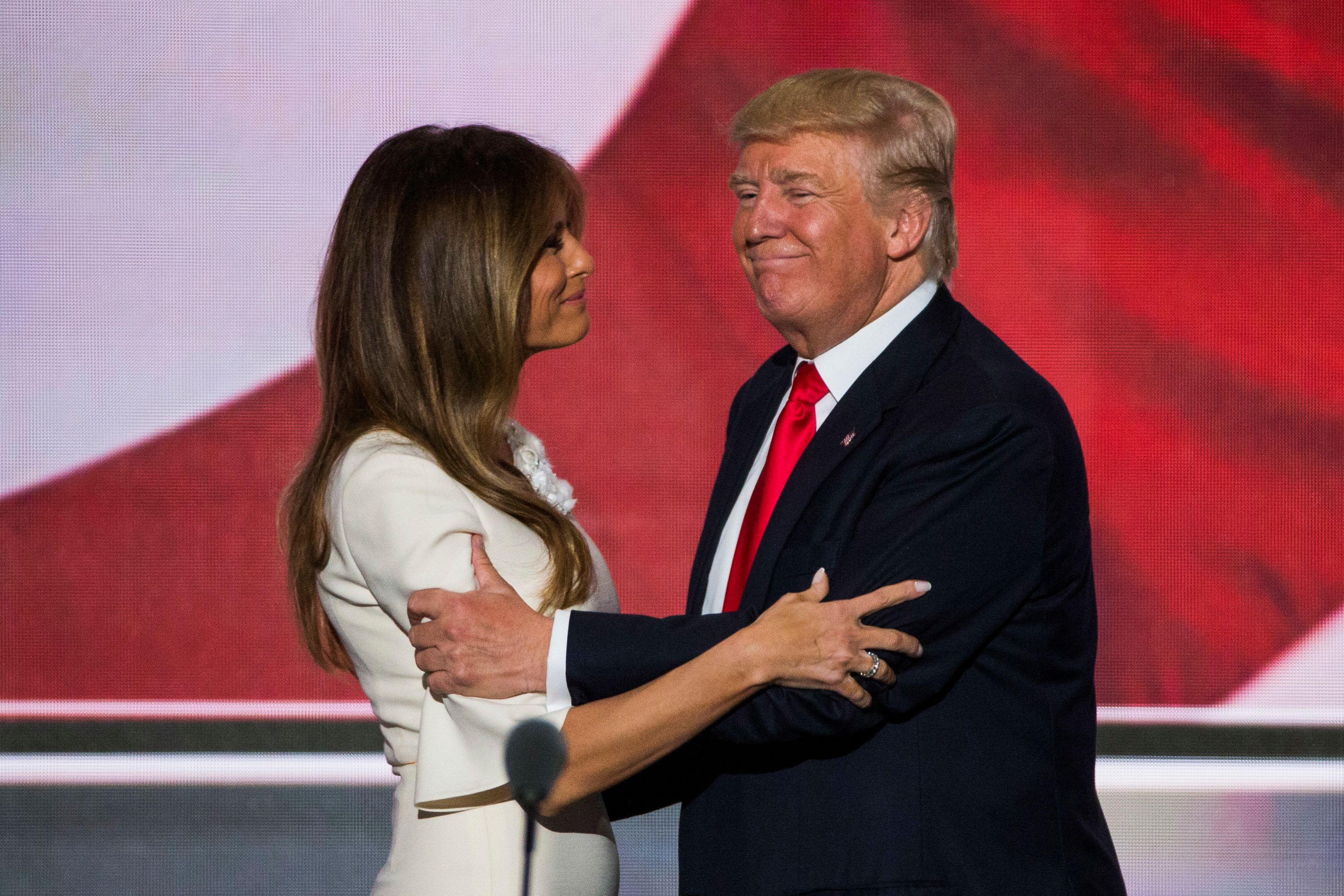 Republican nominee Donald Trump greets his wife Melania after his keynote address to the Republican Convention,...