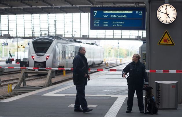 Policemen secure the area on a platform of the train station in Chemnitz, eastern