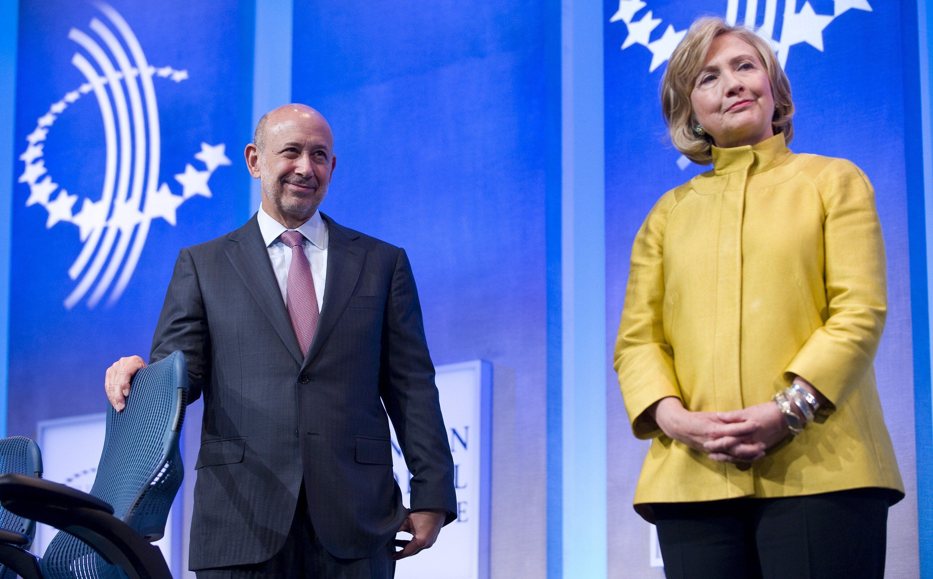 Hillary Clinton stands alongside Lloyd Blankfein, CEO of Goldman Sachs in Sep. 2014. Clinton's ties and paid speeches to