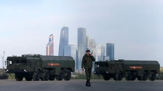 """A Russian serviceman walks past Russian Iskander-M missile launchers before a rehearsal for the Victory Day parade, with the Moscow International Business Center also known as """"Moskva-City"""" seen in the background, at a range in Moscow, Russia, May 5, 2016. REUTERS/Maxim Shemetov"""