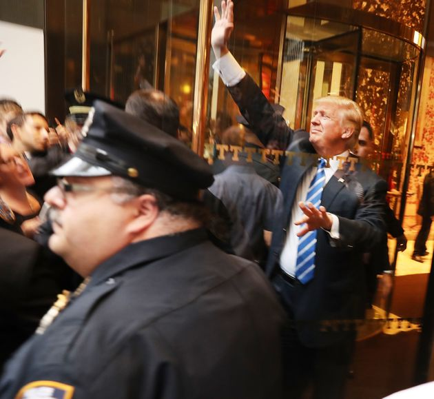 Donald Trump greets supporters outside of Trump Towers in Manhattan October 8, 2016 in New York