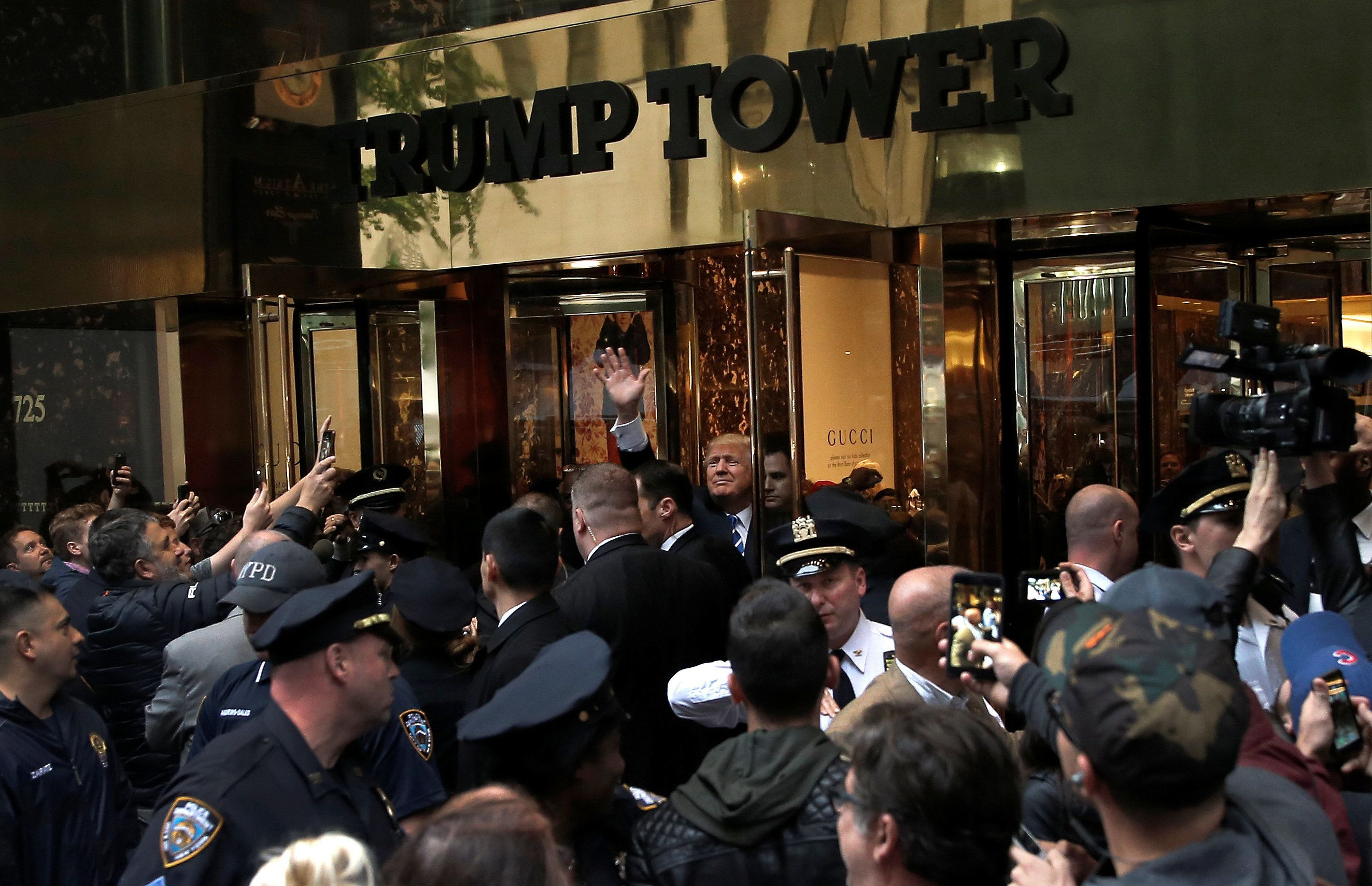Donald Trump waves to supporters outside Trump Tower on
