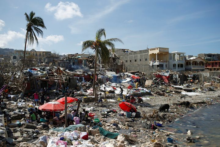People gather at the shore after Hurricane Matthew passes in Jeremie, Haiti, October 8, 2016
