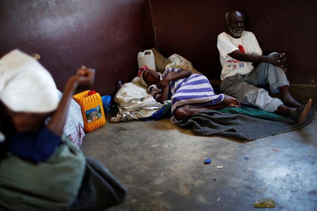 People rest at a shelter set up at a school after Hurricane Matthew passes in Jeremie, Haiti, October...