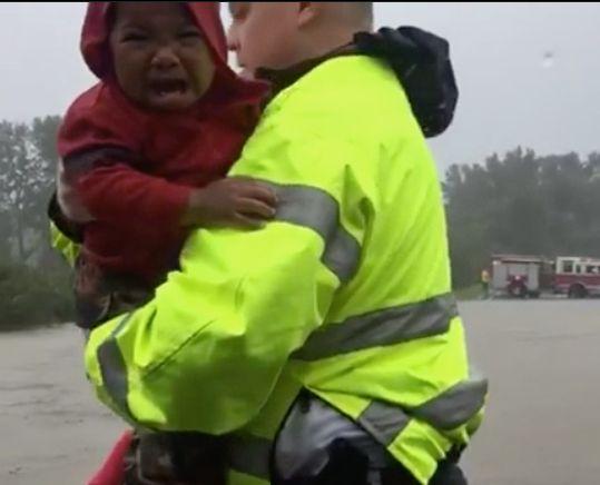 Police rescue a little boy in North Carolina.