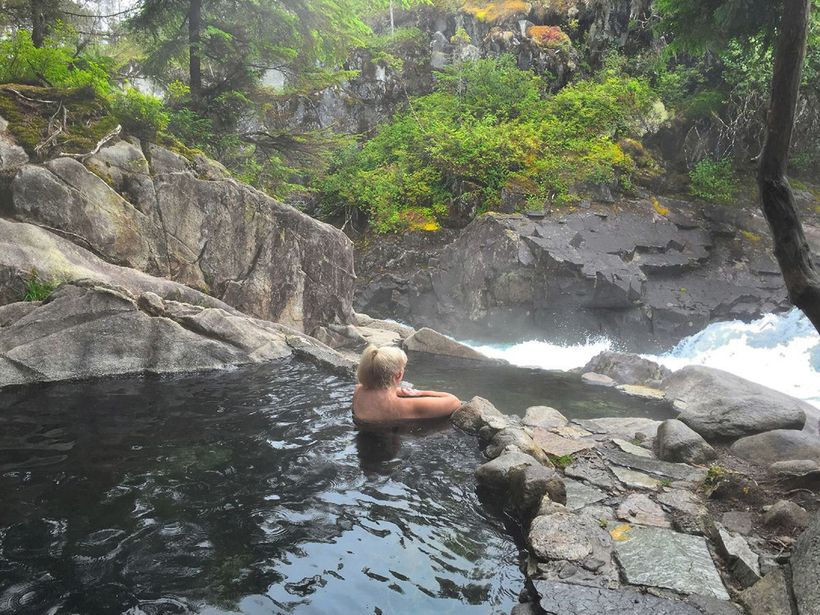 The natural hot spring overlooking the rapids