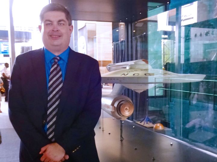 S. Daniel Carter with the original filming model of the U.S.S. Enterprise at the National Air and Space Museum in Washington,