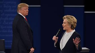US Democratic presidential candidate Hillary Clinton (R) speaks as US Republican presidential candidate Donald Trump listens during the second presidential debate at Washington University in St. Louis, Missouri, on October 9, 2016. / AFP / Robyn Beck        (Photo credit should read ROBYN BECK/AFP/Getty Images)