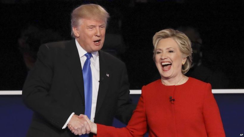 Trump and Clinton shaking hands after their first debate.