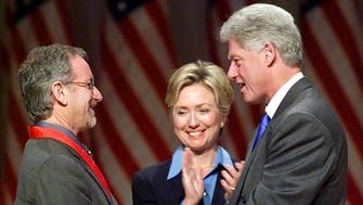 WASHINGTON, :  US President Bill Clinton (R) along with First Lady Hillary Rodham Clinton (C) congratulates movie producer Steven Spielberg (L) after awarding him with the 1999 National Medal of Arts and Humanities Award 29 September 1999 at Constitution Hall in Washington, DC. (ELECTRONIC IMAGE) AFP PHOTO/Stephen JAFFE (Photo credit should read STEPHEN JAFFE/AFP/Getty Images)