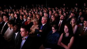 Members of the audience watch as Democratic U.S. vice presidential nominee Senator Tim Kaine and Republican U.S. vice presidential nominee Governor Mike Pence participate in their vice presidential debate at Longwood University in Farmville, Virginia, U.S., October 4, 2016.  REUTERS/Kevin Lamarque  TPX IMAGES OF THE DAY