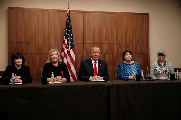 Donald Trump sits with (from R-L) Paula Jones, Kathy Shelton, Juanita Broaddrick and Kathleen Willey in a hotel conference ro