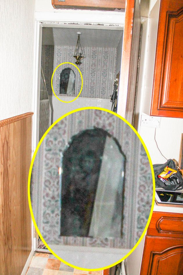 This picture, taken in June, purportedly shows an eerie face in a hooded black robe, staring out of a...
