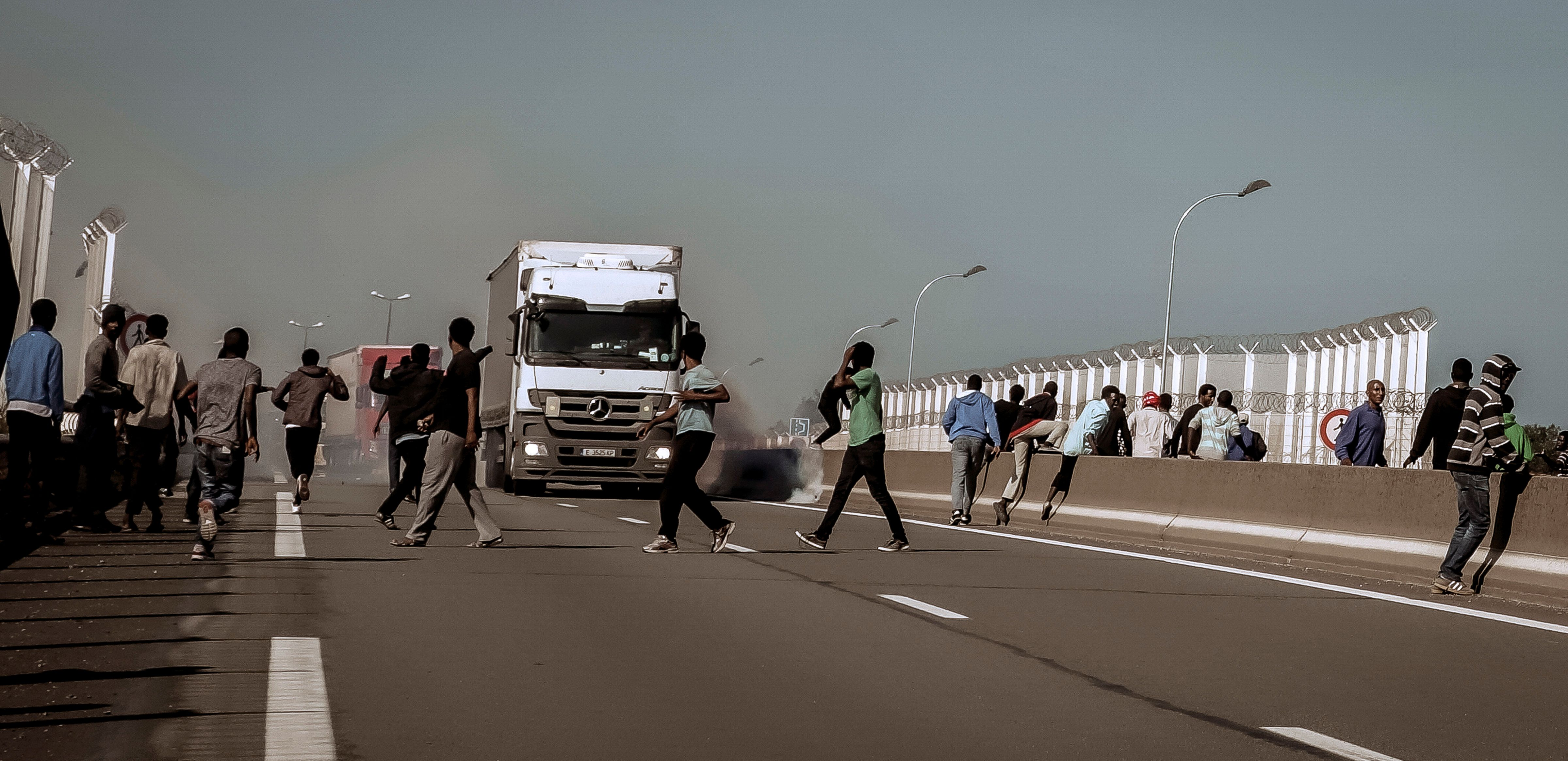 An Eritrean migrant was killed and his wife was injured near Calais after being struck by a car as dozens...
