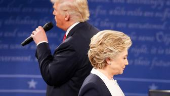 Republican U.S. presidential nominee Donald Trump speaks during the presidential town hall debate with Democratic U.S. presidential nominee Hillary Clinton at Washington University in St. Louis, Missouri, U.S., October 9, 2016. REUTERS/Lucy Nicholson