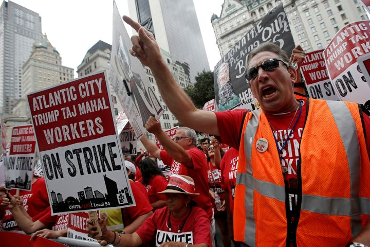 Striking workers from the Trump Taj Mahal Casino in Atlantic City, New Jersey, protest outside the offices of investor and ca