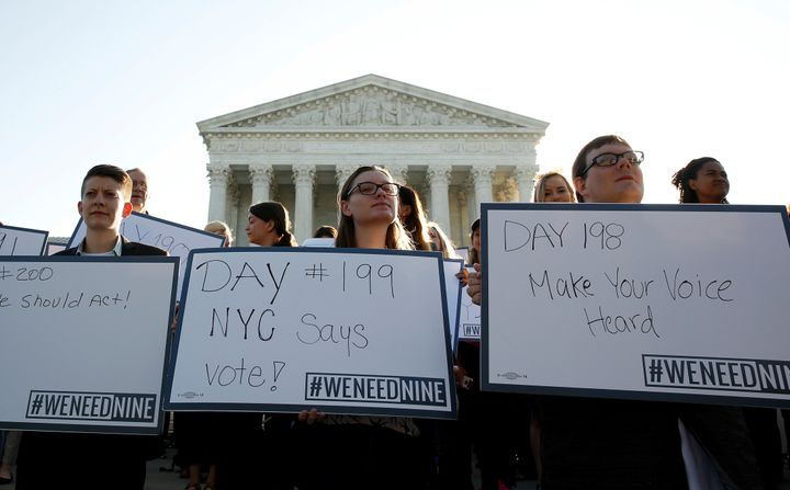 Activists gather outside the Supreme Court to protest the more than 200 days that Judge Merrick Garland, President Barack Oba