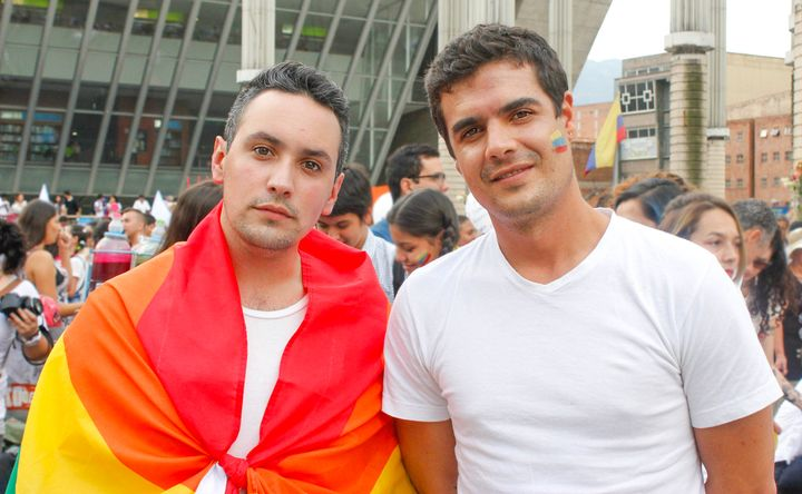 """José Rollano and Pedro Fajardo join marchers in Medellín's Park of Lights on October 7 because they believe """"peace is now the"""