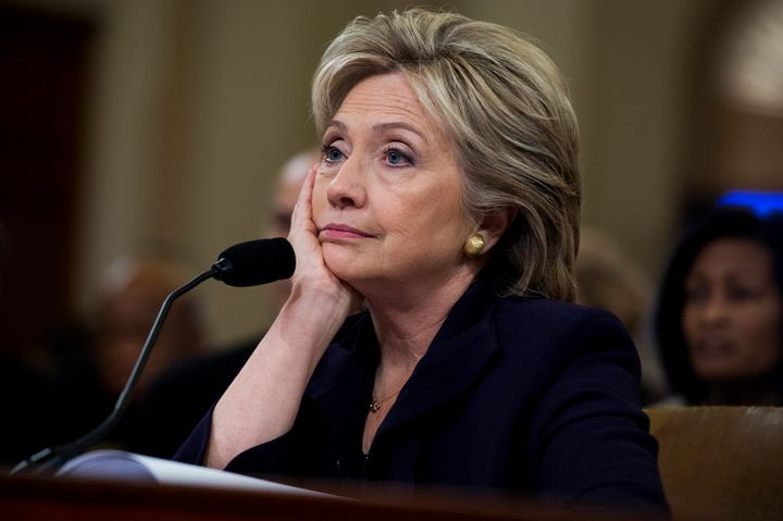 Secretary of State Hillary Clinton appearing bored during an 11-hour hearing held by the House Select Committee on Bengh