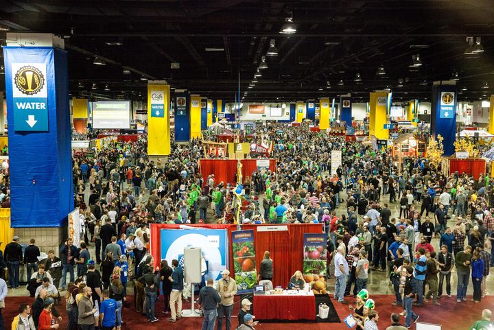 Attendees swarm a section of themainhall at the Colorado Convention Center during the Great American Beer Festival.