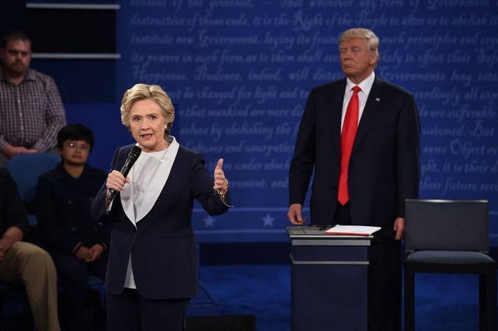 Hillary Clinton, Donald Trump and Donald Trump's necktie stand on the debate stage at Washington University in St. Louis, Missouri.