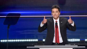 Actor Scott Baio speaks on the first day of the Republican National Convention on July 18, 2016 at the Quicken Loans Arena in Cleveland, Ohio. The Republican Party opened its national convention Monday, kicking off a four-day political jamboree that will anoint billionaire Donald Trump as its presidential nominee. Some 2,000 delegates descended on a tightly secured Cleveland arena where Trump's wife will take center stage later in the day to make a personal pitch to voters that her billionaire husband is the best candidate for the White House. / AFP / Robyn BECK        (Photo credit should read ROBYN BECK/AFP/Getty Images)