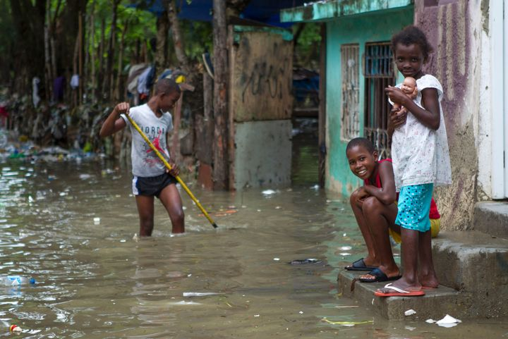 Children are pictured in the flooded neighborhood of La Puya, in Santo Domingo, on Oct. 4, 2016, after Hurricane Matthew thro