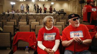 Attendees wearing social security-themed AARP shirts await the start of an event for John Kasich, governor of Ohio and 2016 Republican presidential candidate, in Madison, Wisconsin, U.S., on Monday, March 28, 2016. Kasich would beat Democratic presidential front-runner Hillary Clinton in a national general-election matchup, according to a Bloomberg Politics poll conducted by Iowa-based Selzer & Co. Photographer: Luke Sharrett/Bloomberg via Getty Images