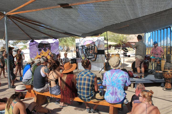 "Festival-goers listening to music in the ""Positive Vibration Station."""