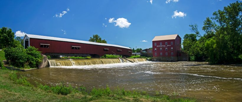 The Bridgeton Covered Bridge spans the creek, over a waterfall.
