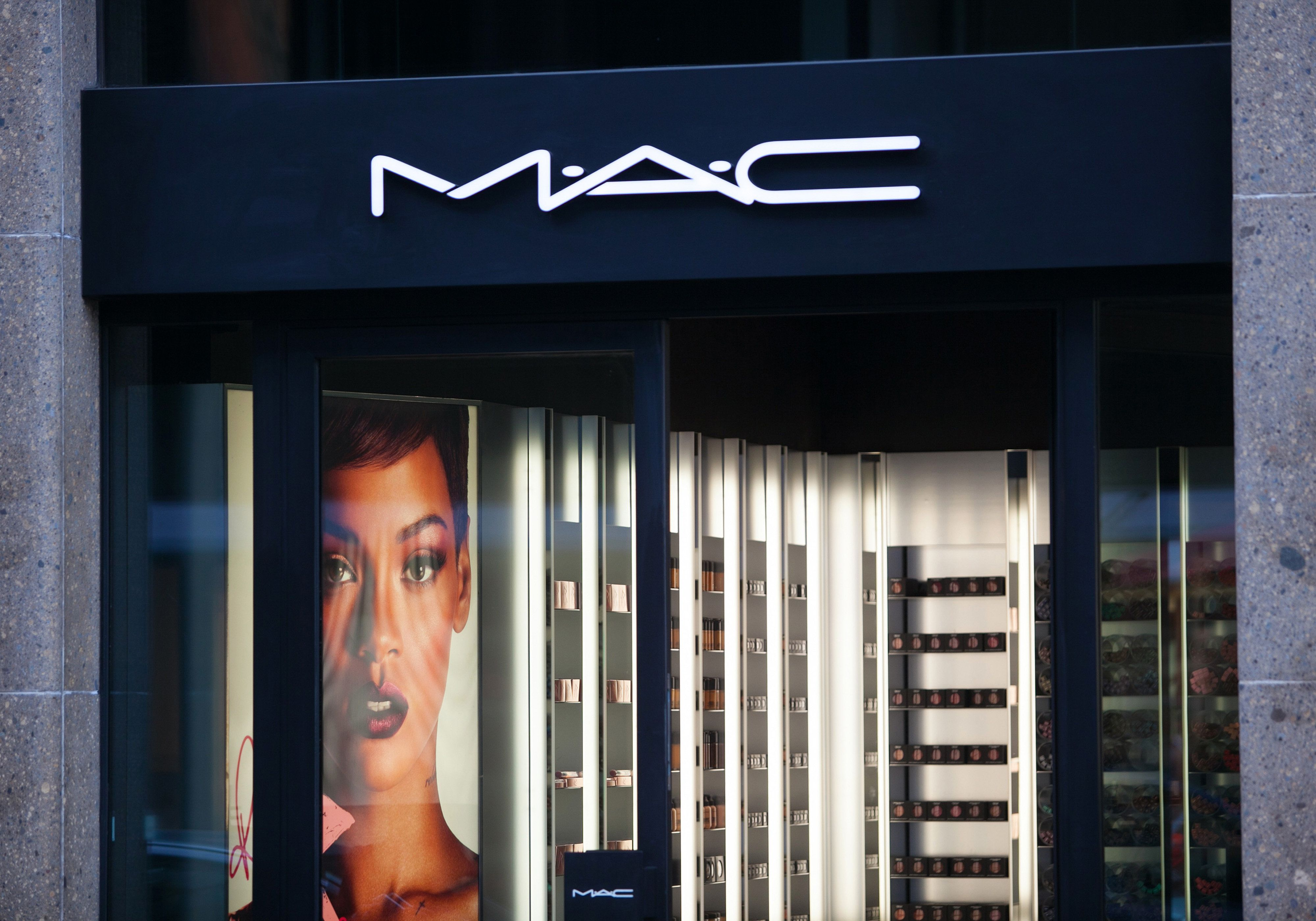A logo sits above the entrance to a M.A.C Cosmetics Inc. store, operated by Estee Lauder Cos., in Dusseldorf, Germany, on Tuesday, Oct. 1, 2013. The Bundesbank said last month that German growth is still being supported by an 'extraordinarily good' consumer climate, in part due to the labor market. Photographer: Krisztian Bocsi/Bloomberg via Getty Images