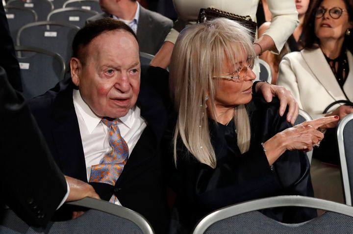Billionaire casino magnate Sheldon Adelson sits with his wife Miriam as they await the start of the first debate between Repu