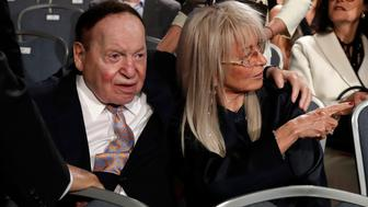 Las Vegas casino magnate Sheldon Adelson sits with his wife Miriam as they await the start of the first debate between Republican U.S. presidential nominee Donald Trump Democratic and U.S. presidential nominee Hillary Clinton at Hofstra University in Hempstead, New York, U.S., September 26, 2016. REUTERS/Lucas Jackson