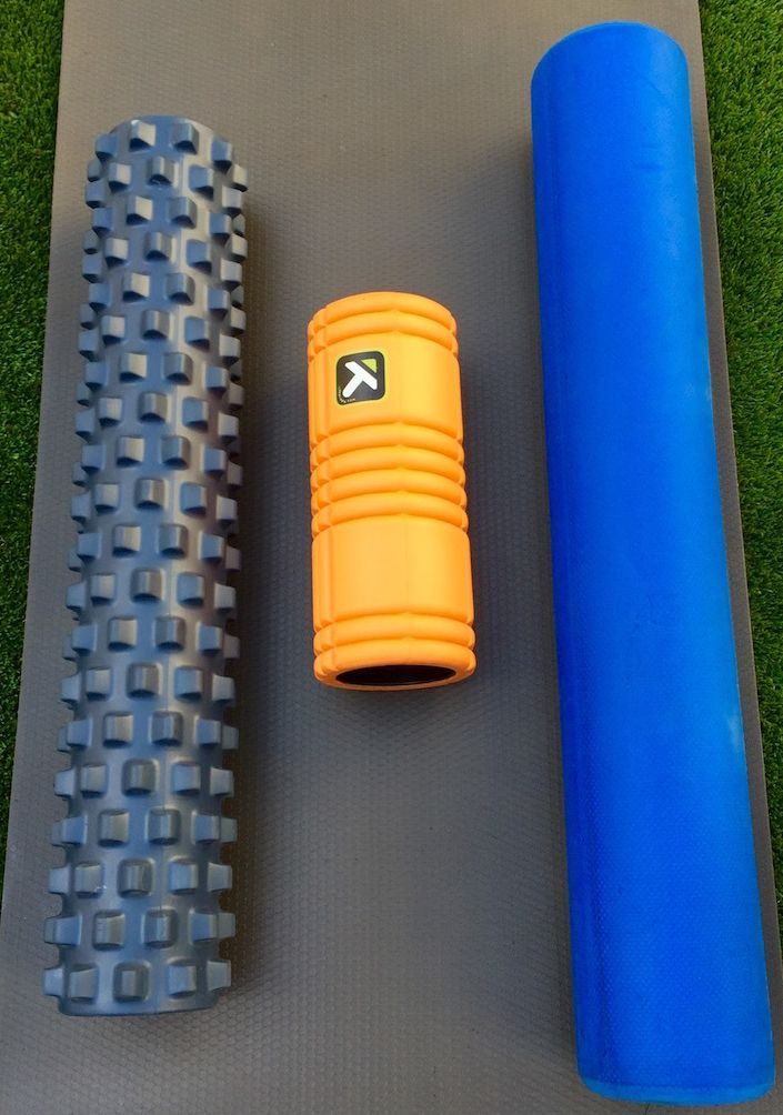 "My rollers left to right:  Bumpy Roller (aka ""meat grinder); the Trigger Point Grid; an old school foam roller"