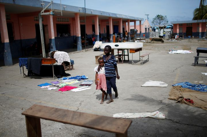 Children walk at a shelter after Hurricane Matthew passes in Jeremie, Haiti, October 9, 2016.