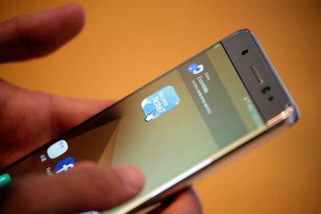A customer tries out a Samsung Electronics' Galaxy Note 7 at the company's headquarters in Seoul, South...